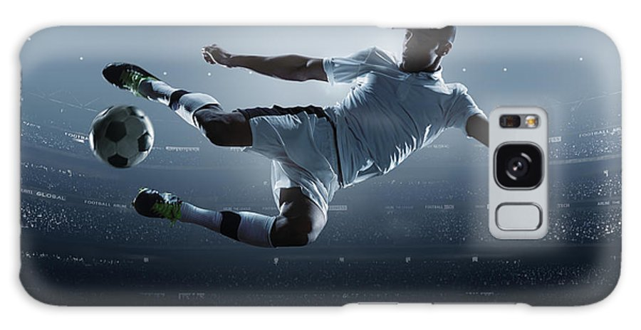 Goal Galaxy Case featuring the photograph Soccer Player Kicking Ball In Stadium by Dmytro Aksonov