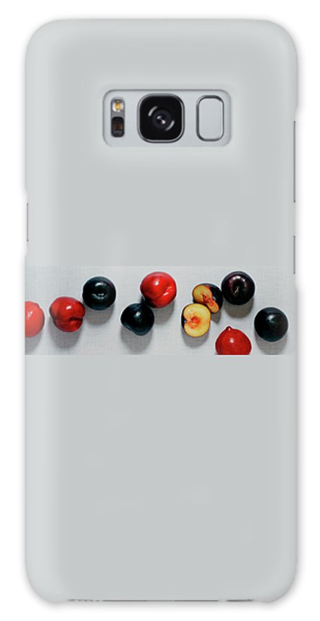 Fruits Galaxy S8 Case featuring the photograph A Bunch Of Plums by Romulo Yanes