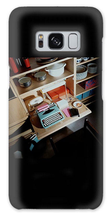 Indoors Galaxy S8 Case featuring the photograph A Cupboard With A Blue Typewriter by Ernst Beadle