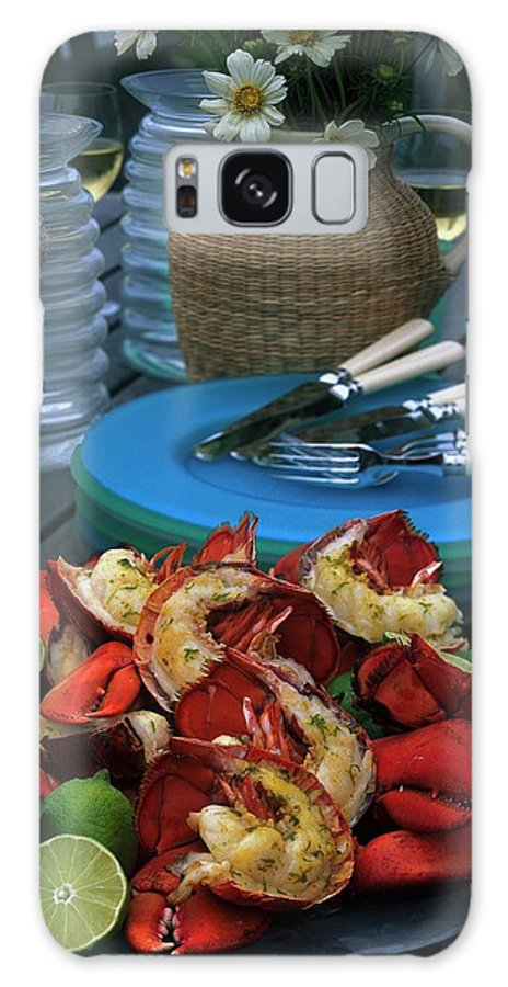 Still Life Galaxy S8 Case featuring the photograph A Meal With Lobster And Limes by Romulo Yanes
