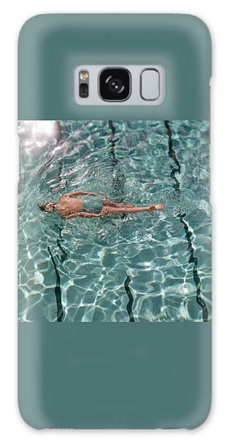 A Woman Swimming In A Pool Galaxy Case