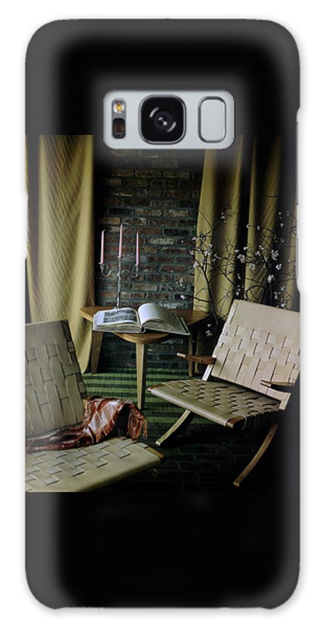 Nobody Galaxy S8 Case featuring the photograph An Armchair Beside A Table And An Old Book by Horst P. Horst