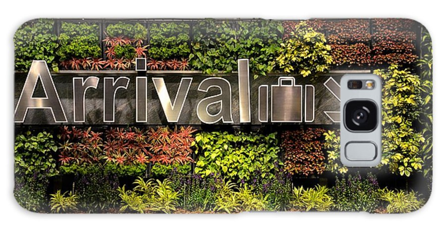 Arrival Galaxy S8 Case featuring the photograph Arrival Sign Arrow And Flowers At Singapore Changi Airport by Imran Ahmed