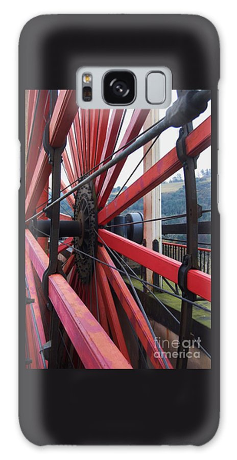 Water Wheel Close Up Wooden Spokes Isle Of Man Dramatic Angle Black Cogs And Braces Glimpse Of Scenery Industrial Art Travel Outdoors Isle Of Man Vertical Vision Iconic Landmark Canvas Print Wood Print Suggested Metal Frame Poster Print Available On Greeting Cards Tote Bags Phone Cases T Shirts Shower Curtain Yoga Mats Spiral Note Books And Mugs Galaxy S8 Case featuring the photograph On The Isle Of Man, Lady Isabella Wheel Close Up by Marcus Dagan