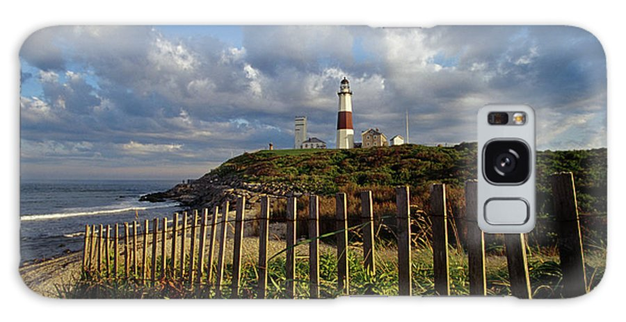 Color Images Galaxy S8 Case featuring the photograph Lighthouse At Montauk With Dramatic Sky by Skip Brown