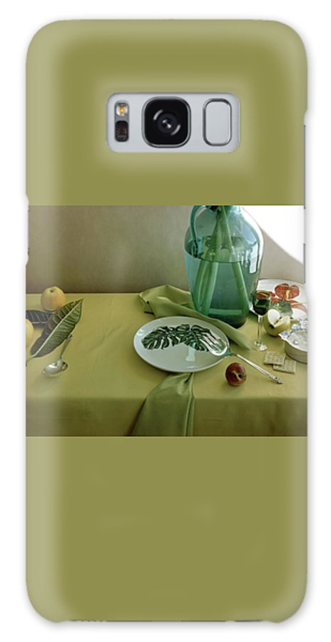 Table Setting Galaxy S8 Case featuring the photograph Plates, Apples And A Vase On A Green Tablecloth by Horst P. Horst