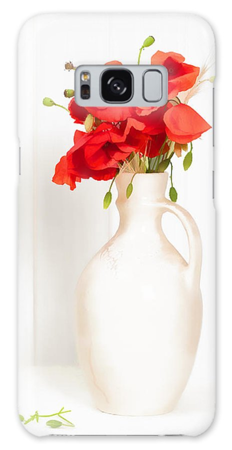Poppy; Poppies; Bright; Red; Vase; Antique; Jug; Table; White; Background; Flowers; Floral; Display; Rustic; Stems; Seedheads; Buds; Green; Spring; Summer; Wild; Flower; Petals Galaxy S8 Case featuring the photograph Poppies by Amanda Elwell