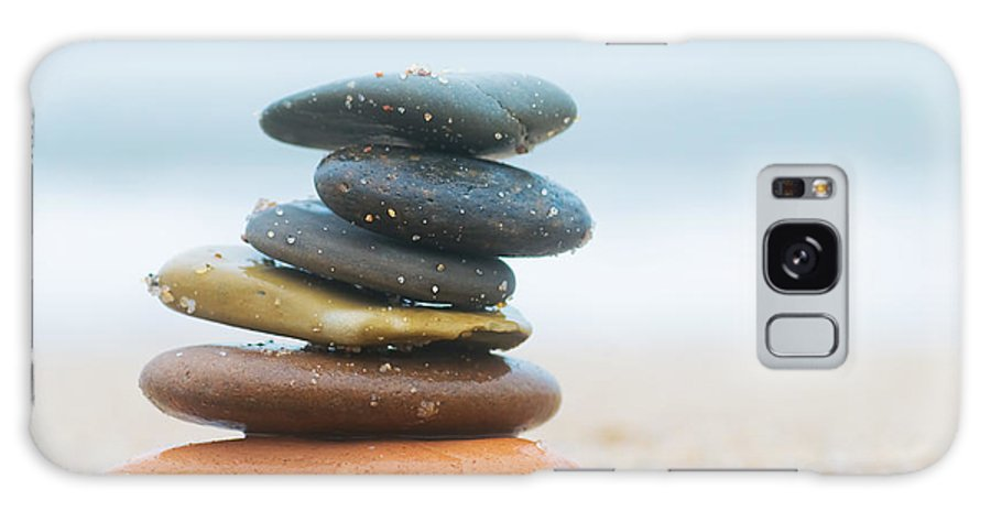 Stone Galaxy S8 Case featuring the photograph Stack Of Beach Stones On Sand by Michal Bednarek