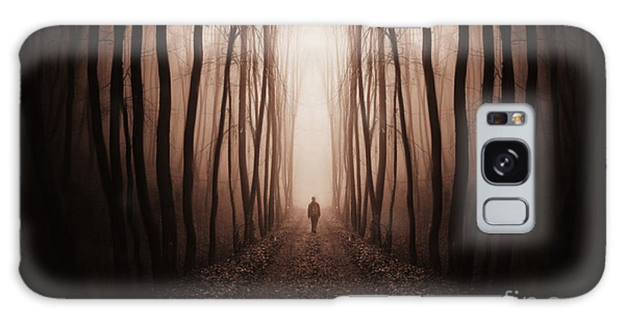 Forest Galaxy S8 Case featuring the photograph Surreal Dark Forest With Man Walking Trough Trees by Photo Cosma