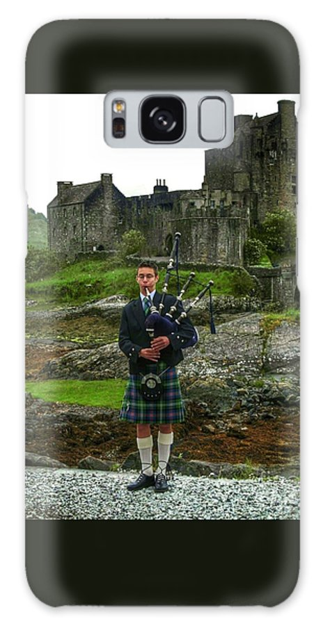 Eileen Dolan Castle Galaxy S8 Case featuring the photograph The Piper At Eilean Donan Castle by Joan-Violet Stretch
