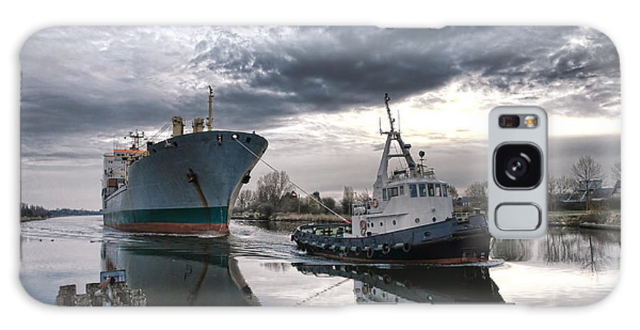 Tugboat Galaxy S8 Case featuring the photograph Tugboat Pulling A Cargo Ship by Olivier Le Queinec