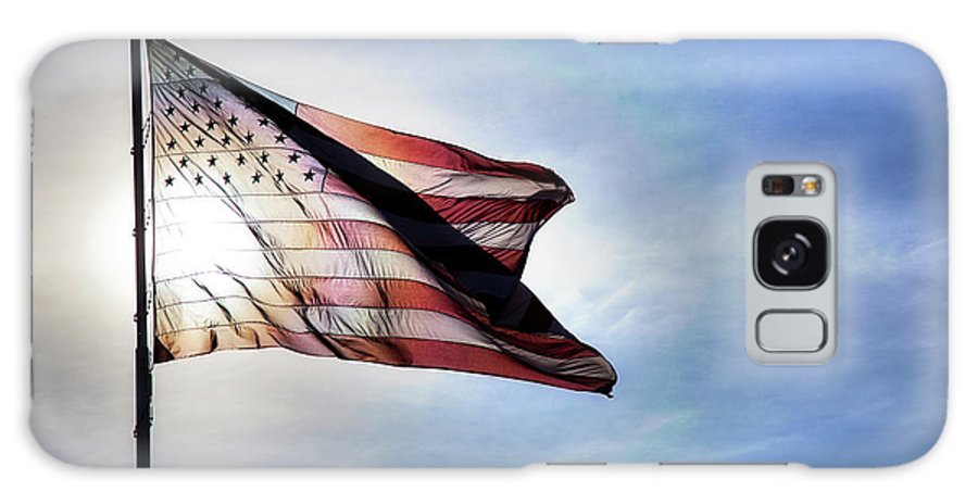 Curve Galaxy Case featuring the photograph Us Flag Fluttering In Backlit Blue Sky by Strickke