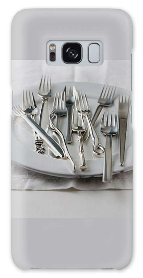 Kitchen Galaxy Case featuring the photograph Various Forks On A Plate by Romulo Yanes
