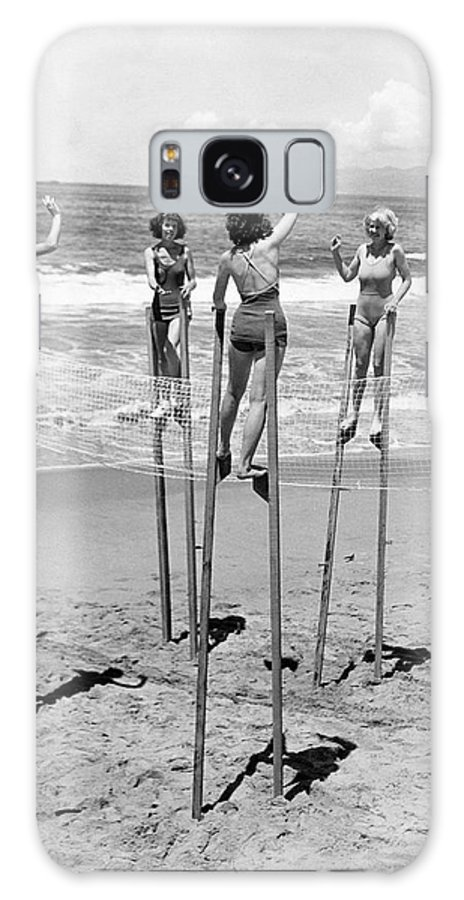 1930's Galaxy Case featuring the photograph Volleyball On Stilts by Underwood Archives