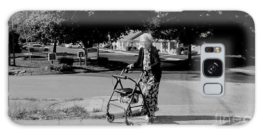 A Happy Elderly Woman Walking To The Grocery Store With Her Walker. Galaxy S8 Case featuring the photograph Walker by Robert Loe