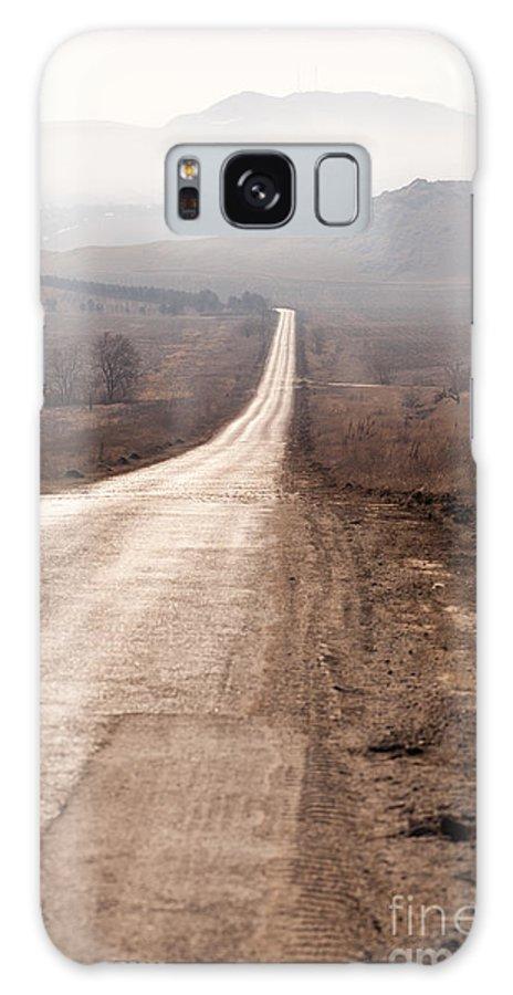 Dobrogea Galaxy S8 Case featuring the photograph Foggy Road In Dobrogea by Gabriela Insuratelu