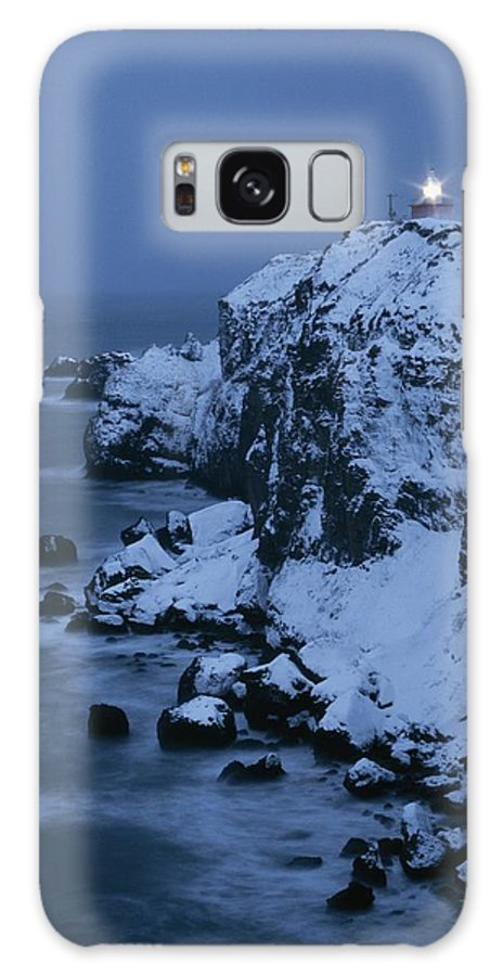 Structures Galaxy S8 Case featuring the photograph A Lighthouse Atop Snow-covered Cliffs by Tim Laman