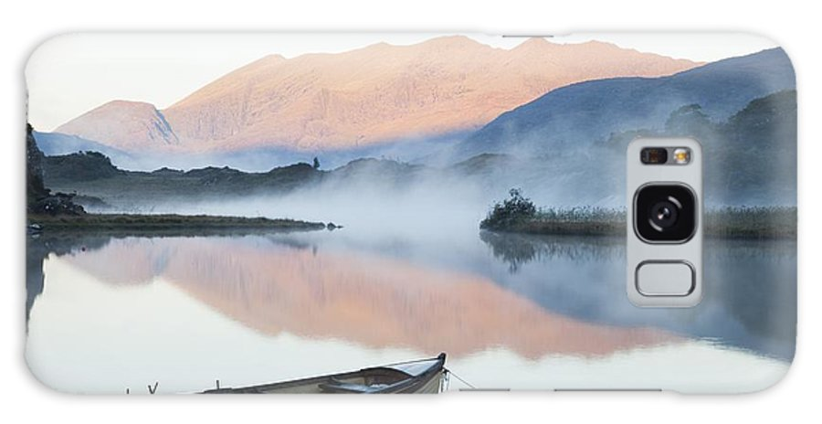 Tranquil Galaxy S8 Case featuring the photograph Boat On A Tranquil Lake Killarney by Peter Zoeller