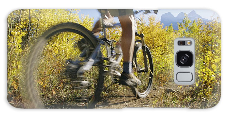 North America Galaxy S8 Case featuring the photograph Cyclist Rides Mountain Bike Among Trees by Mark Cosslett