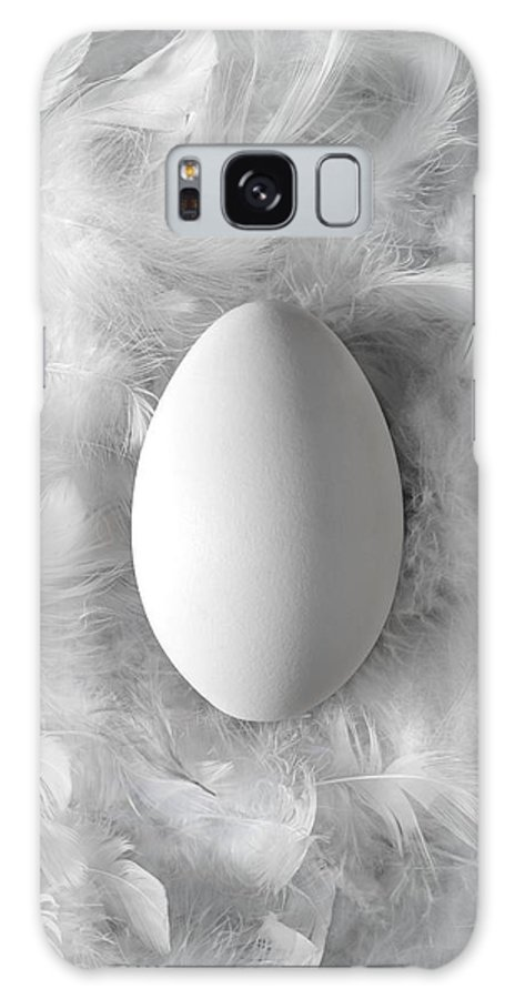 Food Galaxy S8 Case featuring the photograph Egg On Feathers, Conceptual Image by Paul Biddle