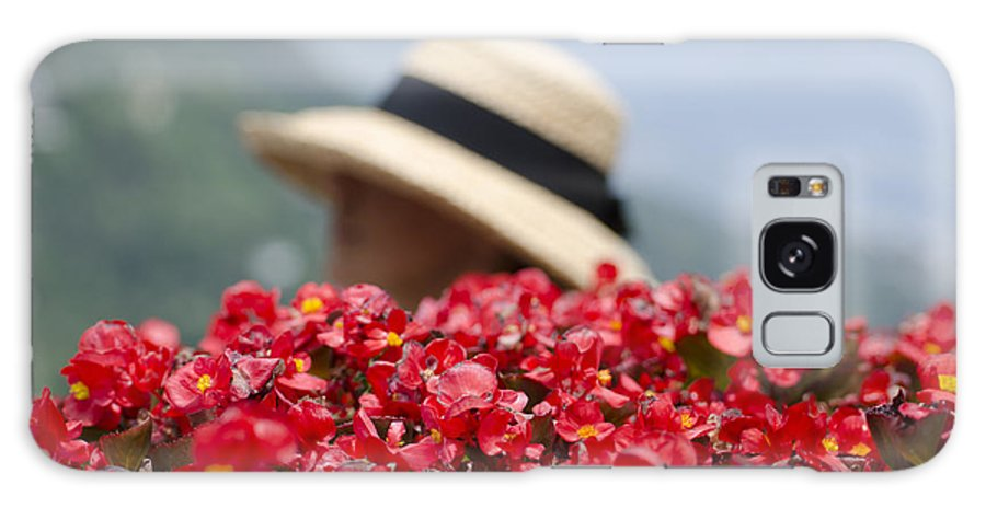 Red Galaxy S8 Case featuring the photograph Red Flowers And Straw Hat by Mats Silvan