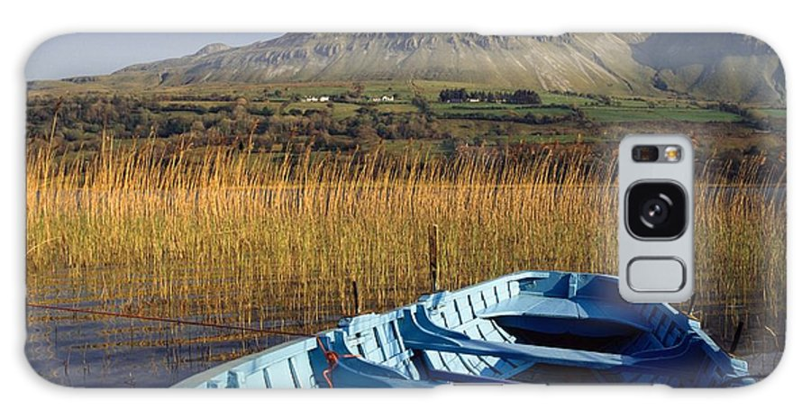 Boats Galaxy S8 Case featuring the photograph Row Boat Amongst Reeds On A Lake by The Irish Image Collection