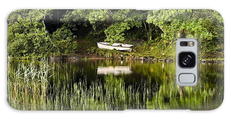 Outdoors Galaxy S8 Case featuring the photograph Rowboat Moored On The Bank Of A Lake by Peter McCabe