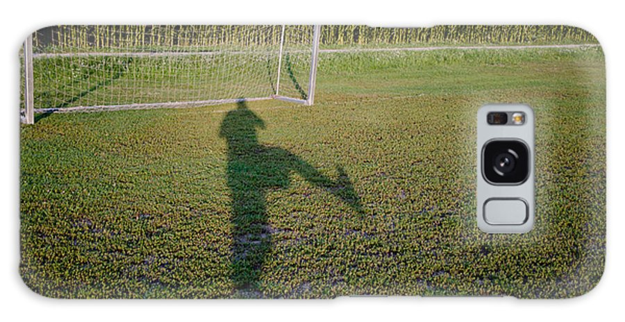 Football Galaxy S8 Case featuring the photograph Shadow From A Football Player by Mats Silvan