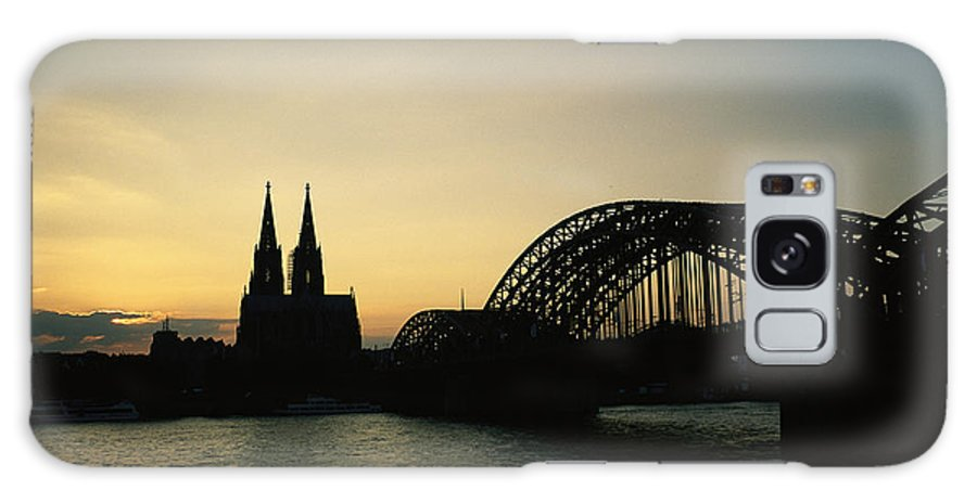 The Cologne Cathedral And Hohenzollern Bridge Silhouetted At Dusk. Galaxy S8 Case featuring the photograph The Cologne Cathedral And Hohenzollern by Raul Touzon