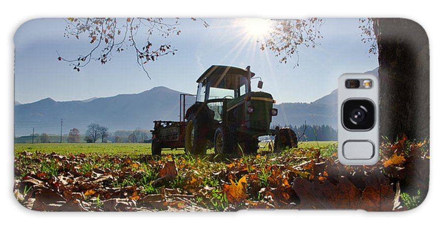 Tractor Galaxy S8 Case featuring the photograph Tractor In Backlight by Mats Silvan