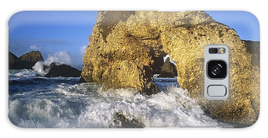 Atlantic Ocean Galaxy S8 Case featuring the photograph Wave Splashing Against Natural Arch by The Irish Image Collection