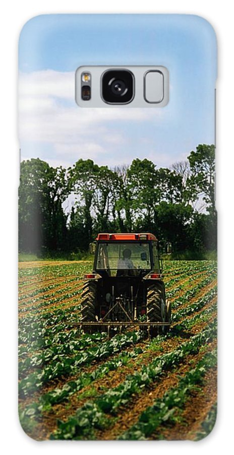 Backhoe Galaxy S8 Case featuring the photograph Weeding A Cabbage Field, Ireland by The Irish Image Collection