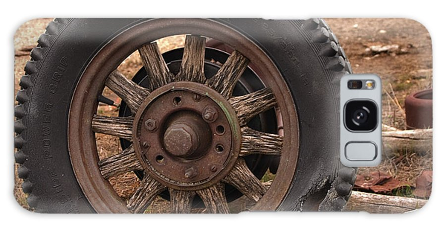 Rubber Galaxy S8 Case featuring the photograph Wooden Spoked Tire by Grant Groberg