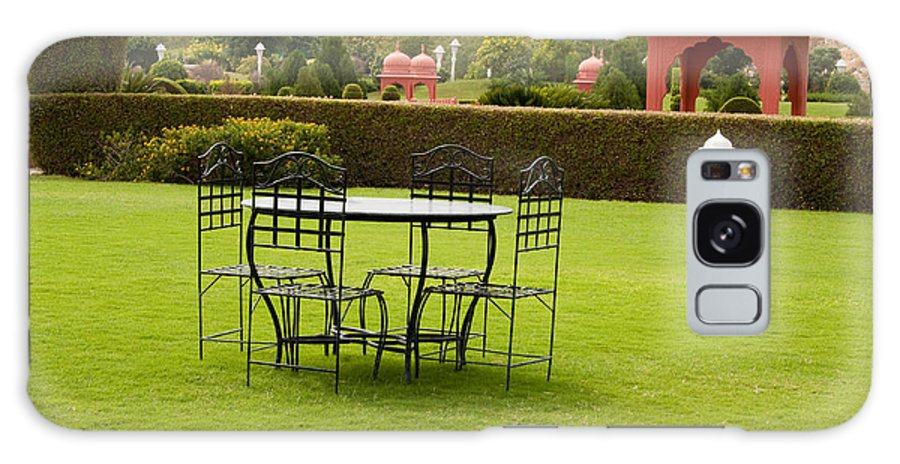 India Galaxy S8 Case featuring the photograph Wrought Metal Chairs Around A Table In A Lawn by Ashish Agarwal