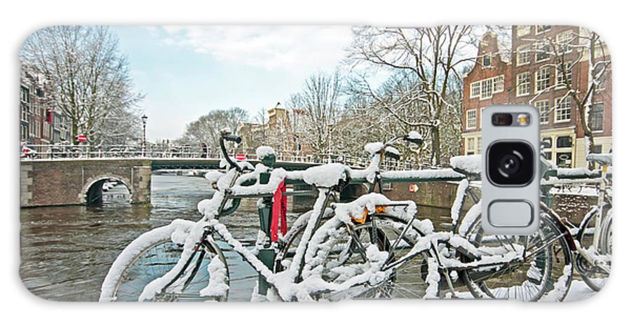 Amsterdam Galaxy S8 Case featuring the photograph snowy Amsterdam in the Netherlands by Nisangha Ji