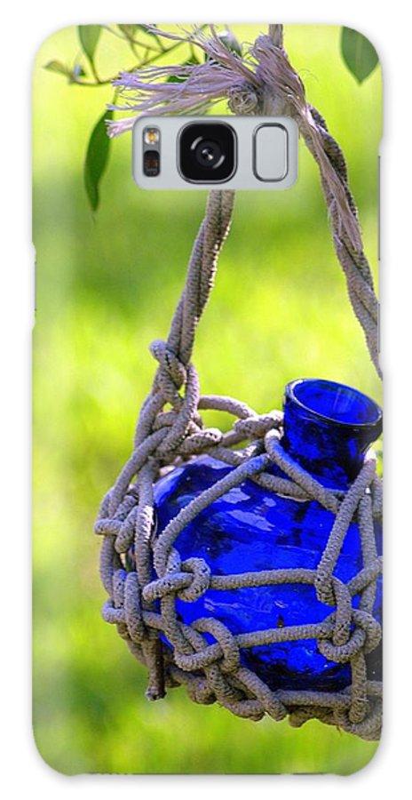 Glass Bottles Galaxy S8 Case featuring the photograph Small Blue Bottle Garden Art by Ginger Wakem