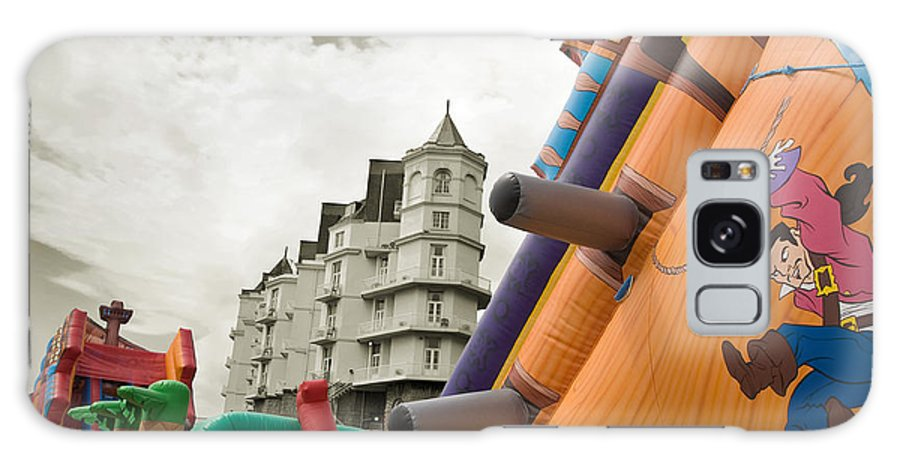 Childrens Galaxy S8 Case featuring the photograph Childrens Play Areas Contrast With The Victorian Elegance Of The Grand Hotel In Llandudno Wales Uk by Mal Bray