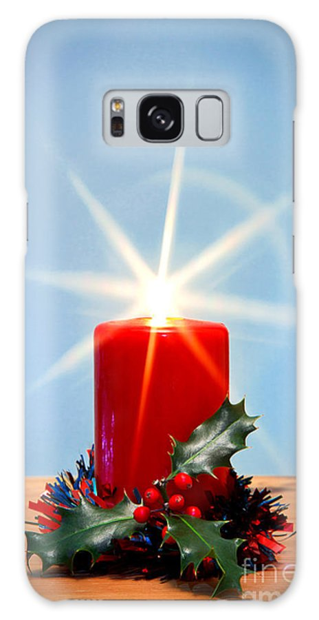Christmas Galaxy S8 Case featuring the photograph Christmas Candle With Starburst And Holly. by Richard Thomas