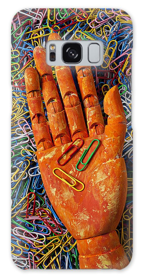 Orange Galaxy S8 Case featuring the photograph Orange Wooden Hand Holding Paperclips by Garry Gay