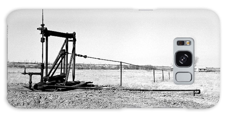 Oil Field Galaxy Case featuring the photograph Pumping Oil by Larry Keahey