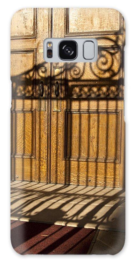 Wood Door Galaxy S8 Case featuring the photograph Shadows On A Wood Door by Sven Brogren