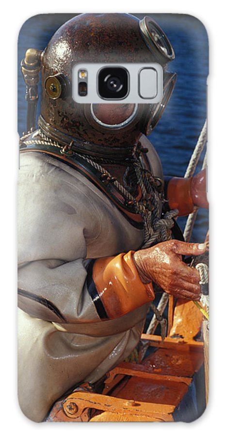 Hard Hat Galaxy Case featuring the photograph Sponge Diver by Carl Purcell