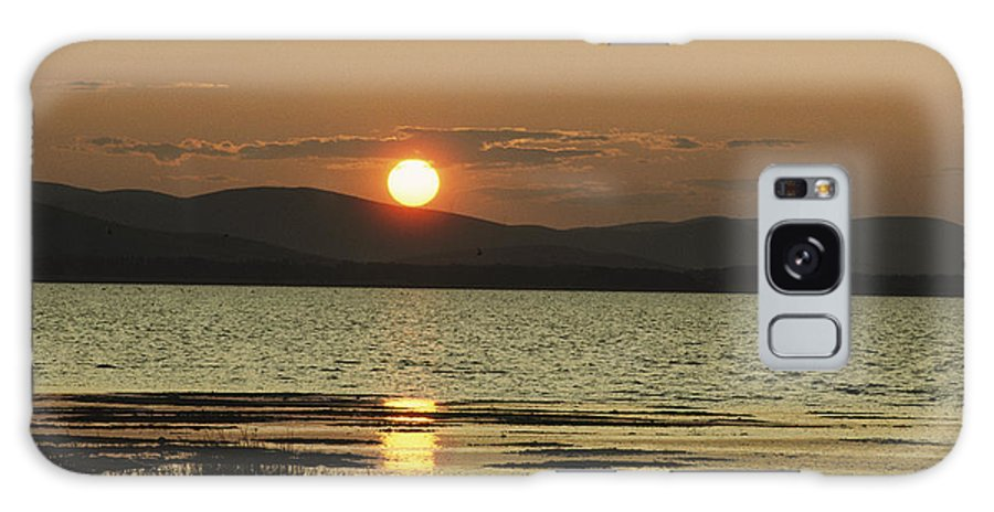 Scenes And Views Galaxy S8 Case featuring the photograph Sunset Over Mountains And Water by Klaus Nigge