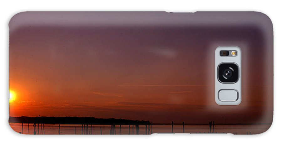 Clay Galaxy Case featuring the photograph The Sun Sets Over The Water by Clayton Bruster