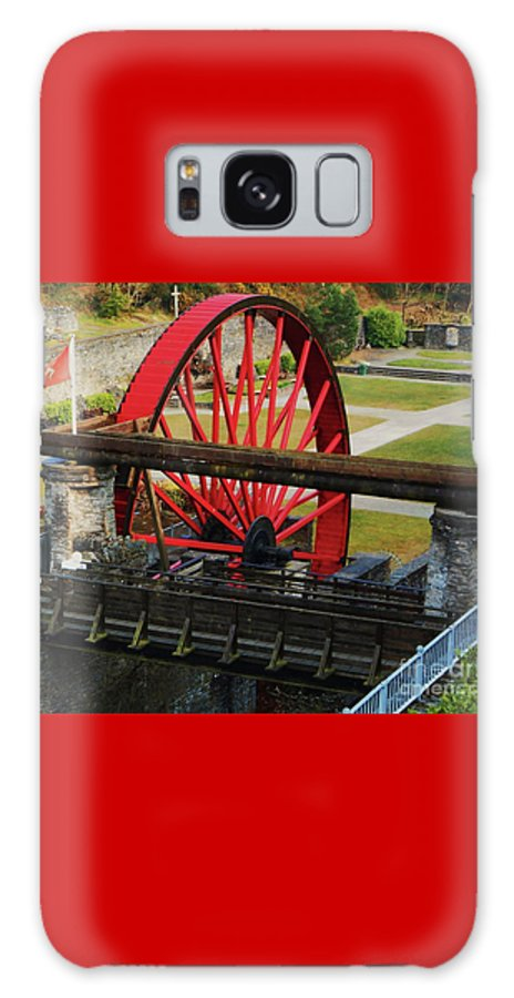Water Wheel Stone Structures Victorian Era Art Isle Of Man Historic Tourism Travel Unique Destination Attraction Robert Casement Manx Flag Landscaped Park Bright Red Wheel Published Work Canvas Print Wood Print Metal Frame Poster Print Available On T Shirts Tote Bags Weekender Tote Bags Pouches Shower Curtains Mugs And Phone Cases Galaxy S8 Case featuring the photograph The Wheel Park, Laxey, Isle Of Man by Courtney Dagan