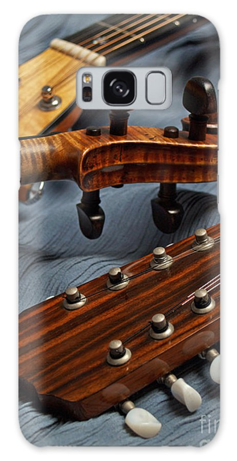 Guitar Galaxy S8 Case featuring the photograph Three Musical Instrument Heads On Blue by Anna Lisa Yoder