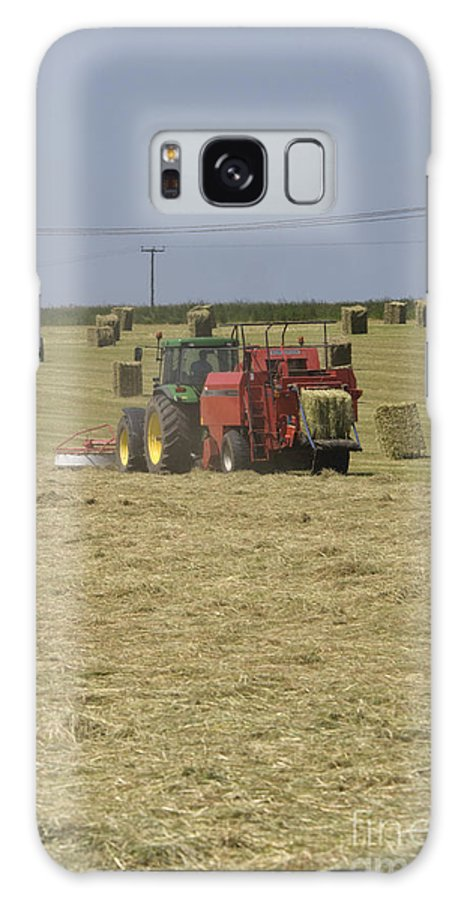 Tractor Galaxy S8 Case featuring the photograph Tractor Bailing Hay In A Field At Harvest Time Pt by Andy Smy