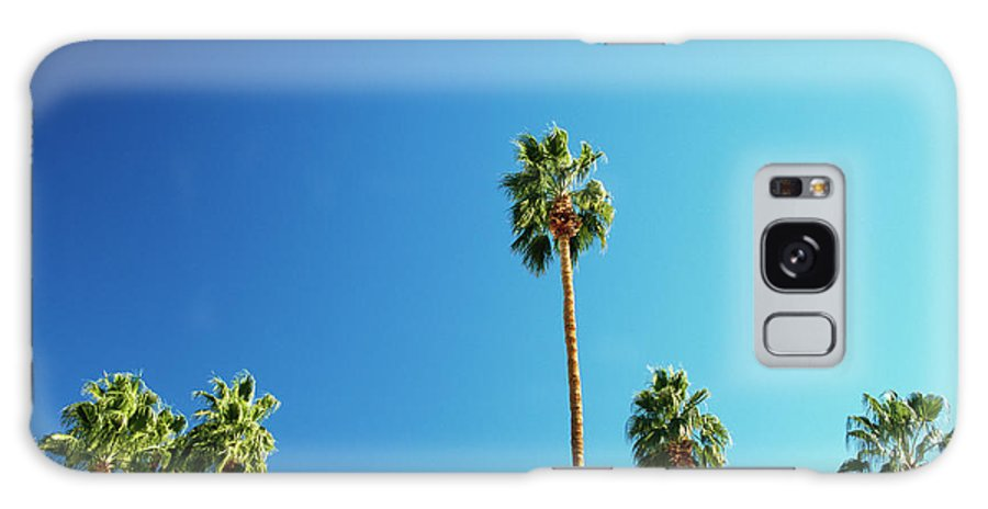 Clear Sky Galaxy Case featuring the photograph Palm Trees Against Blue Sky by Micha Pawlitzki