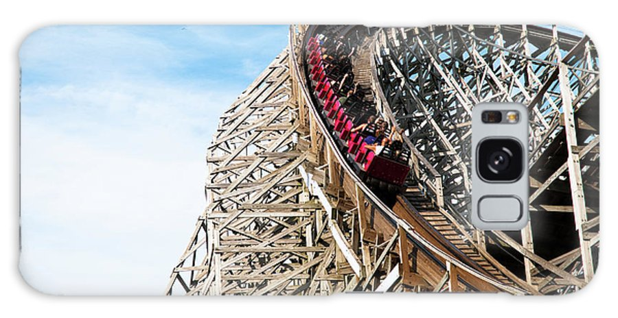 Rail Transportation Galaxy Case featuring the photograph Classic Roller Coaster With People At by Awelshlad