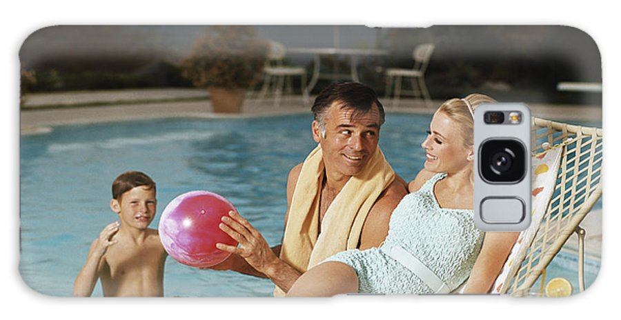 Mid Adult Women Galaxy Case featuring the photograph Father And Son Playing With Beach Ball by Tom Kelley Archive